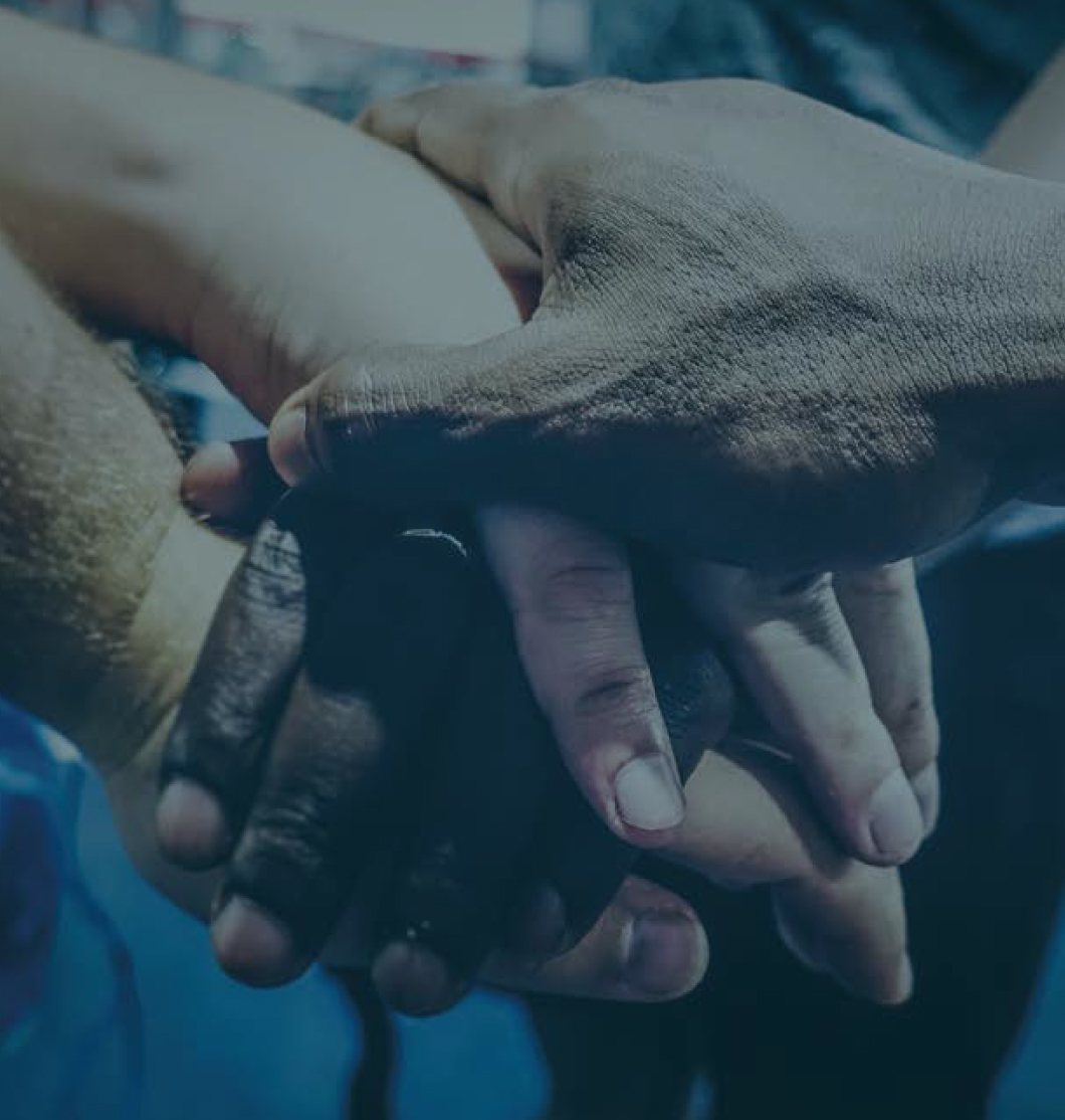 Hands of multiple people | Immigration Solicitor London and North London